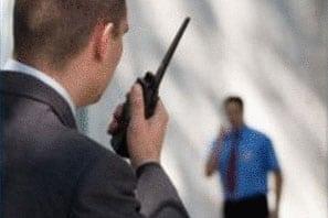 Security-Guard-on-Walkie-Talkie